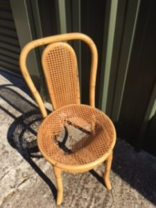 A wooden cane chair before repair