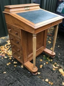 A front view picture of a revamped Davenport Desk with its drawer