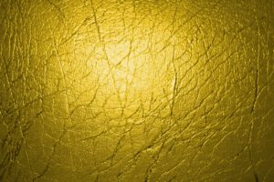 A close up picture of a yellow leather